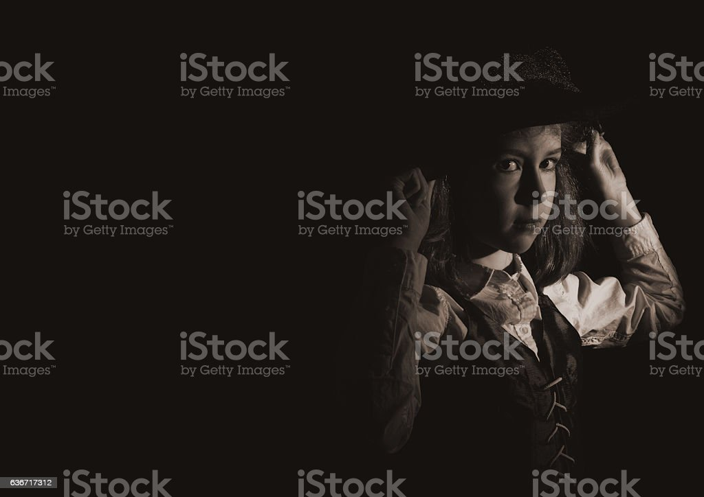 Portrait of little girl in hat and waistcoat. stock photo