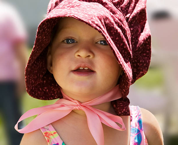 Portrait of little girl in 'pioneer' bonnet stock photo