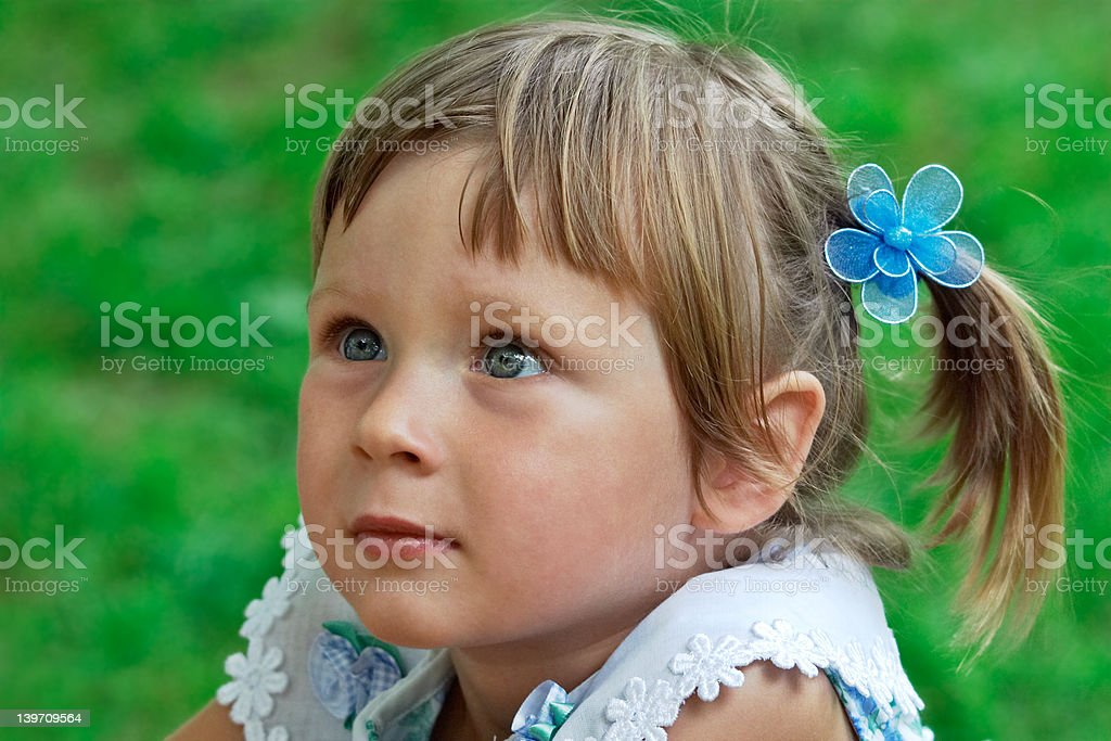 Portrait of little girl listening some story royalty-free stock photo