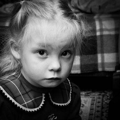 Portrait Of Little Girl Looking Into Camera Stock Photo - Download Image Now