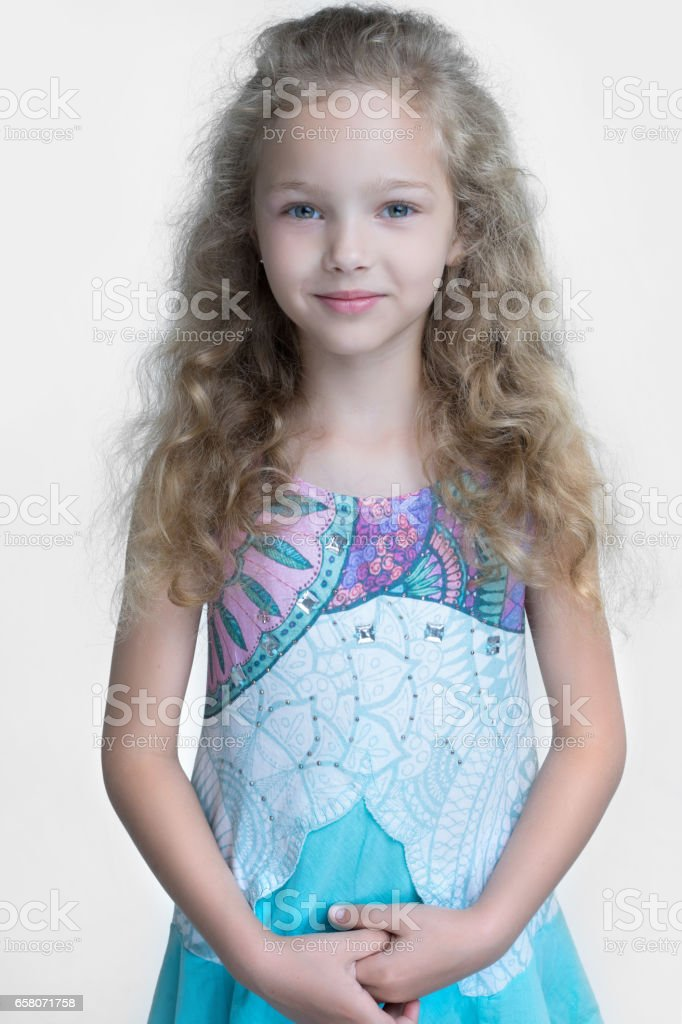 portrait of little girl outdoors in spring; royalty-free stock photo