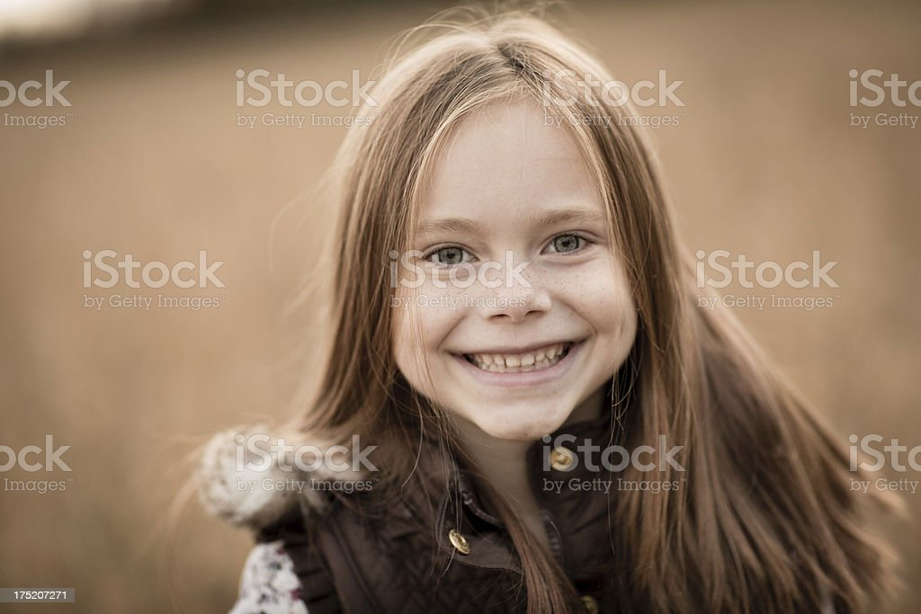 Portrait of Little Girl Standing Outside on Fall Day stock photo