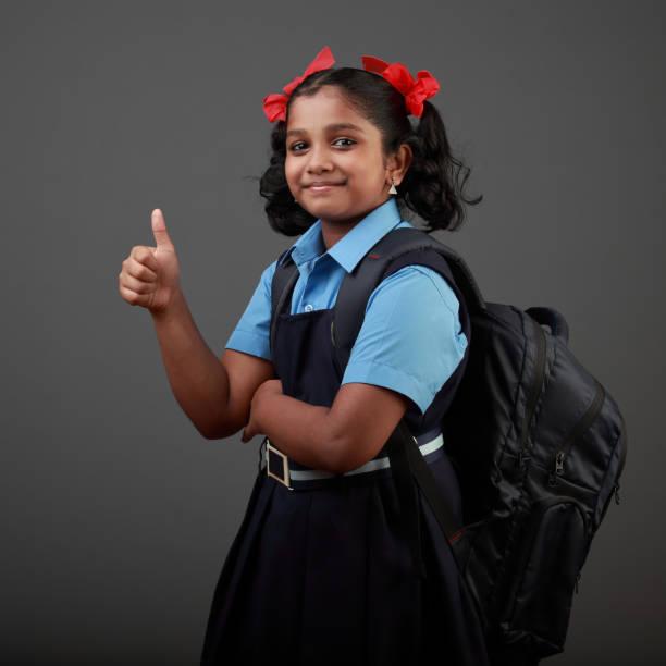 Portrait of little girl wearing school uniform stock photo