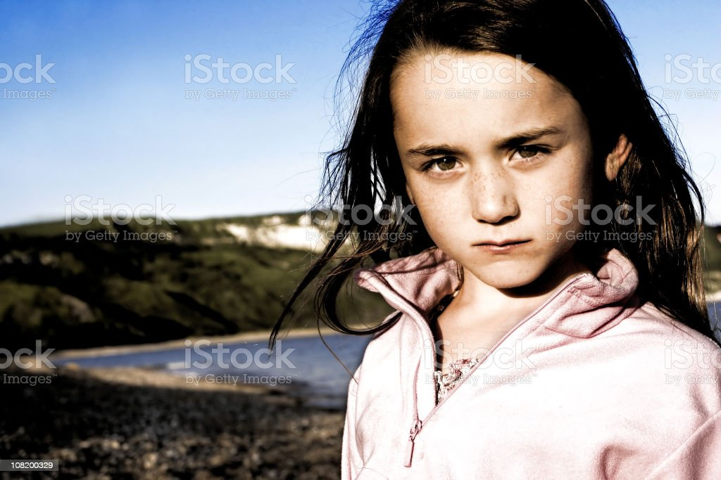 Portrait of Little Girl With Coastline in Background royalty-free stock photo