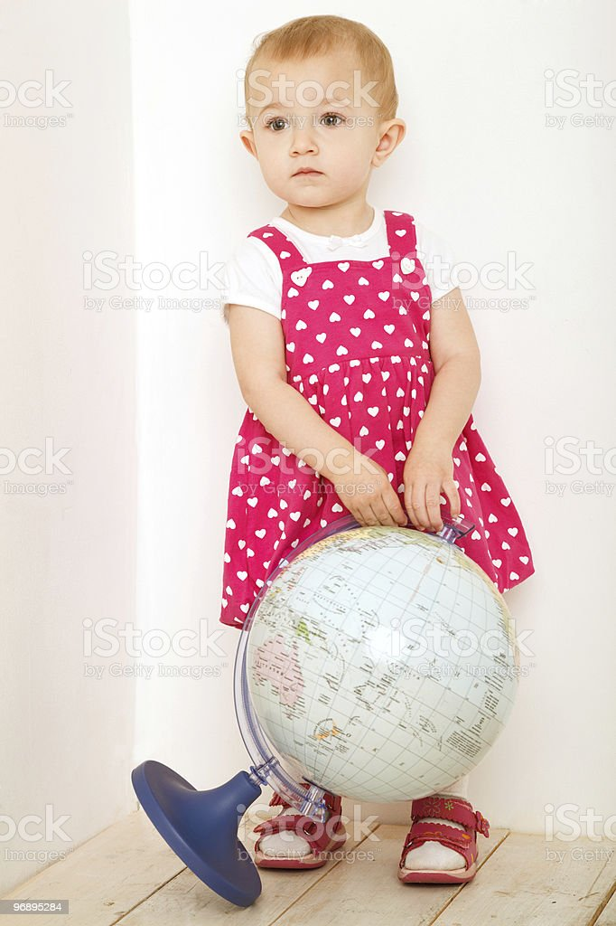 Portrait of little girl with globe. royalty-free stock photo