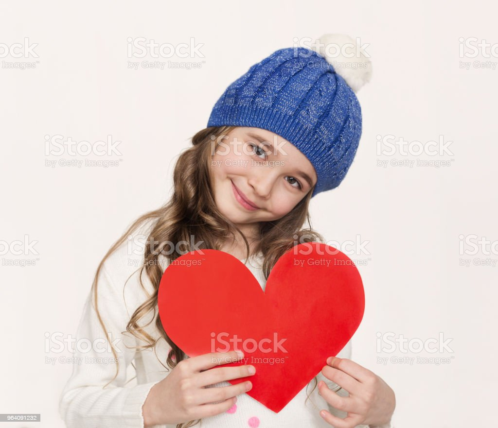 Portrait of little girl with red paper heart at white background - Royalty-free Beautiful People Stock Photo