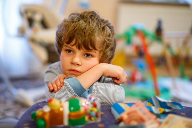 Cтоковое фото Portrait of little kid boy sad on birthday. child with lots of toy