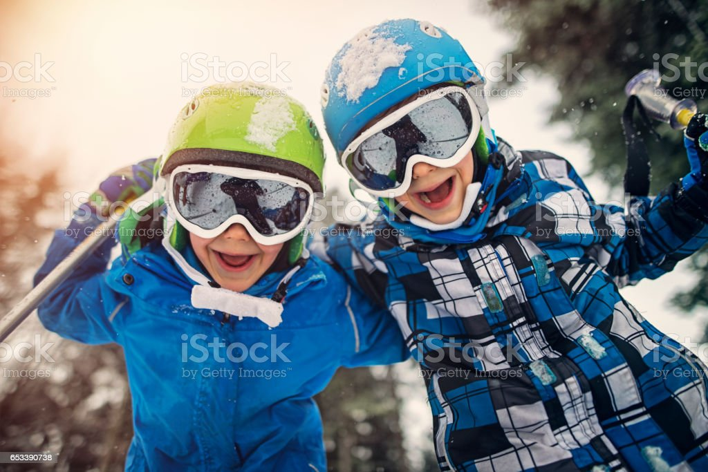 Portrait of little skiers  laughing at the camera stock photo