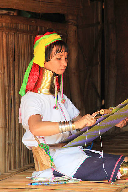 portrait of long neck tribe woman working - kente cloth stock photos and pictures