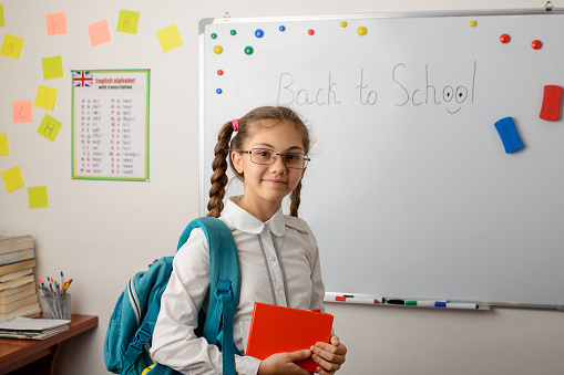 Cheerful girl happy to return to school