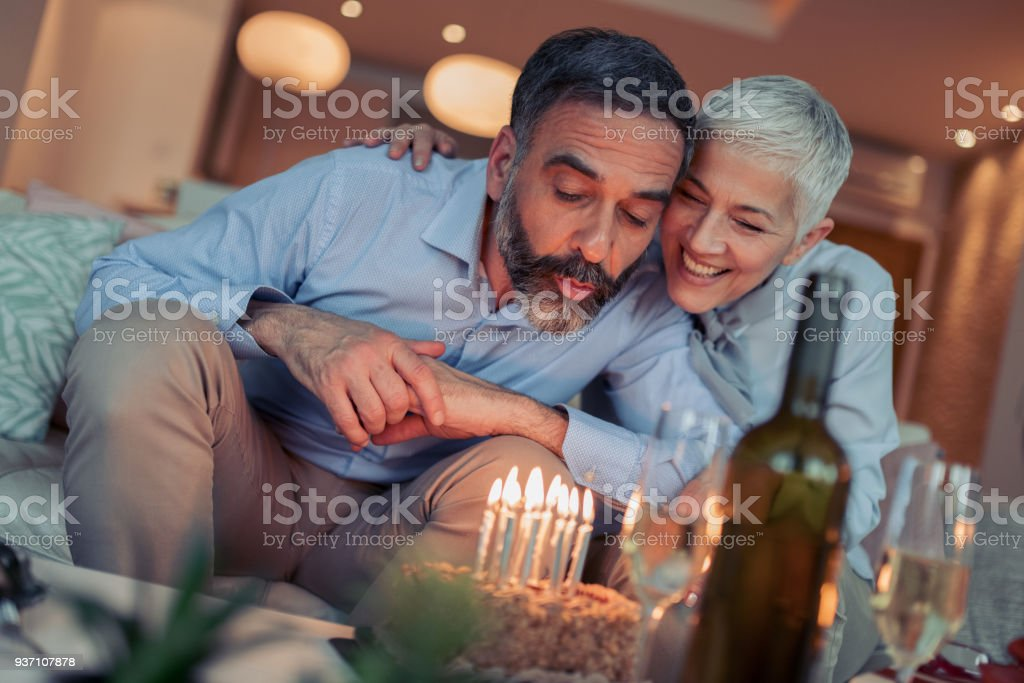 Portrait of loving couple celebrating birthday stock photo
