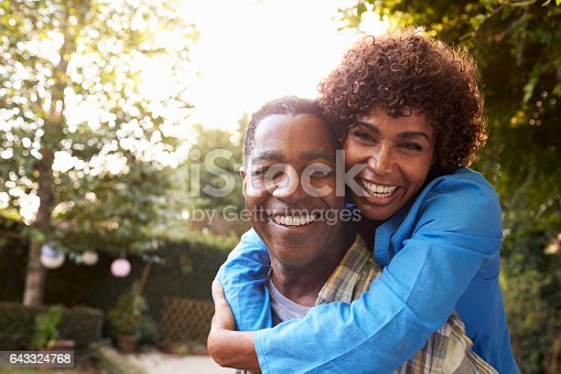 istock Portrait Of Loving Mature Couple In Back Yard Garden 643324768