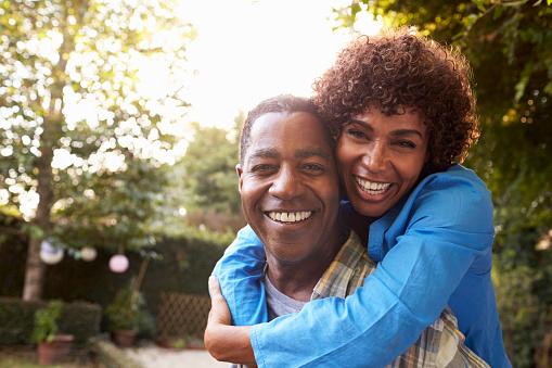 istock Portrait Of Loving Mature Couple In Back Yard Garden 643324768