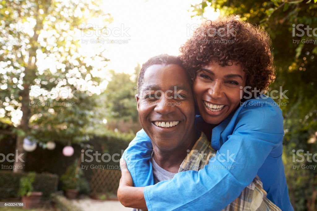 Portrait Of Loving Mature Couple In Back Yard Garden stock photo