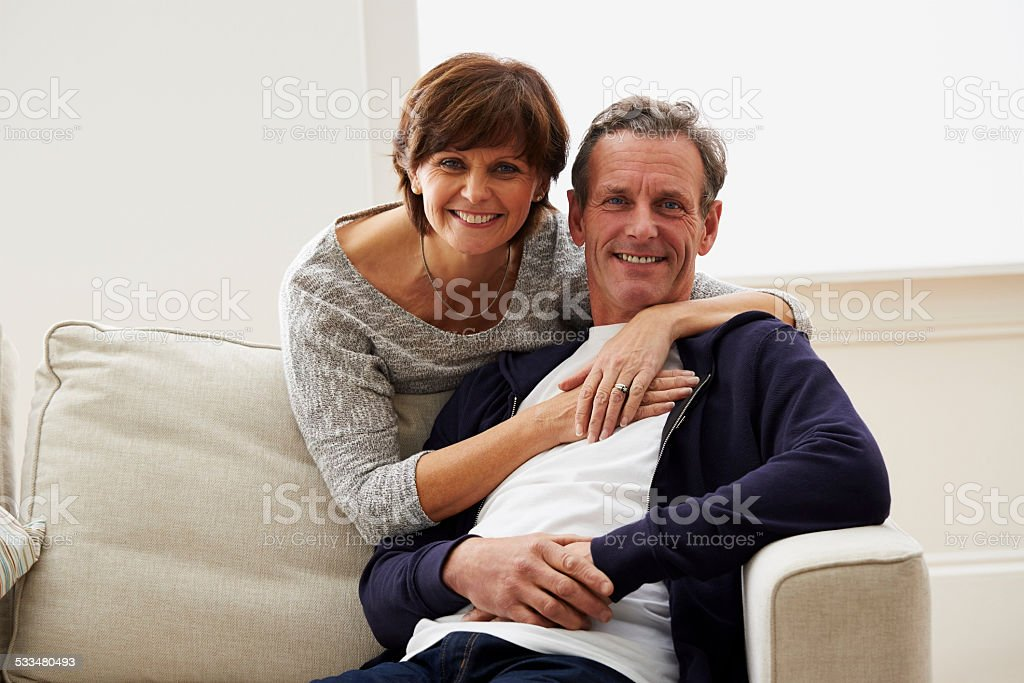 Portrait of loving mature couple together at home stock photo
