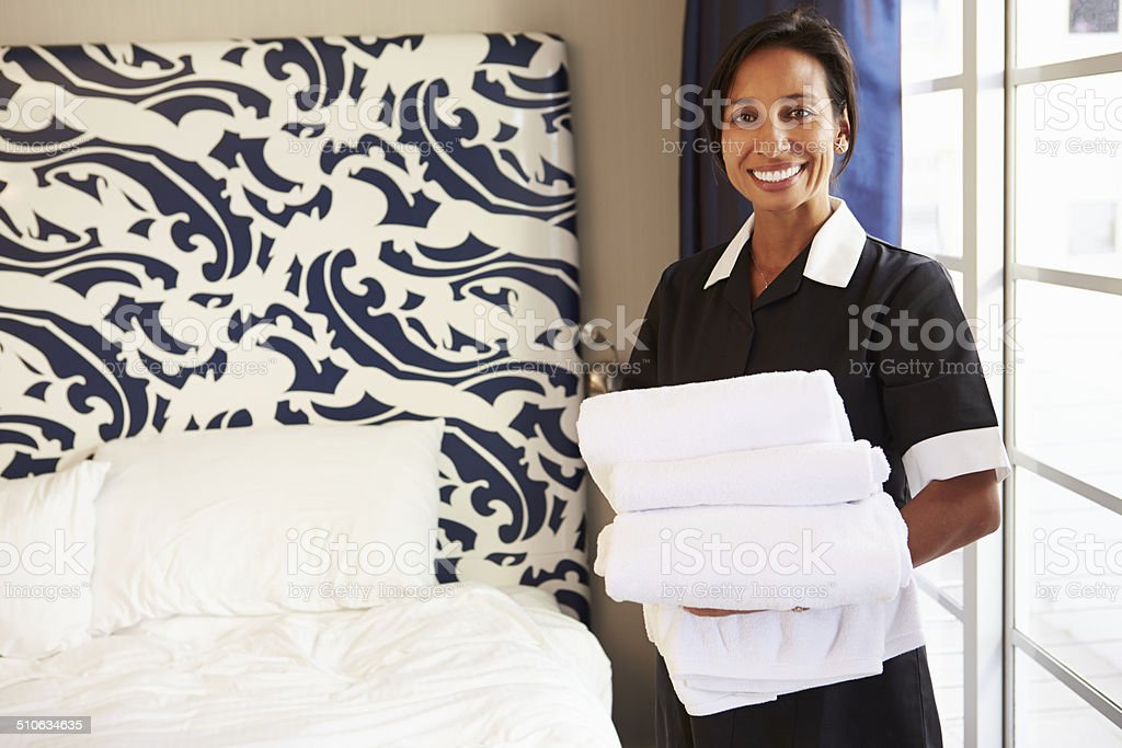 Portrait Of Maid Tidying Hotel Room stock photo