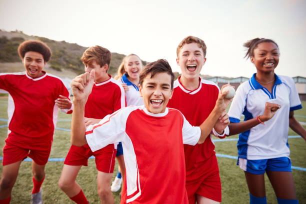 portrait of male and female high school soccer teams celebrating - high school sports stock pictures, royalty-free photos & images