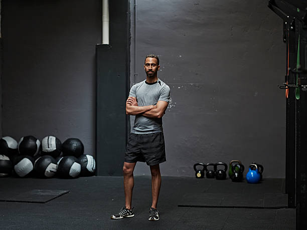 Portrait of male athlete in gym gym stock photo