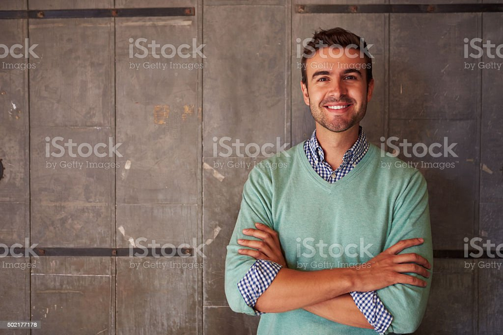 Portrait Of Male Designer Standing In Modern Office stock photo