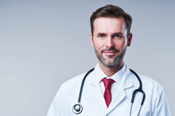 Portrait of male doctor isolated on grey background stock photo