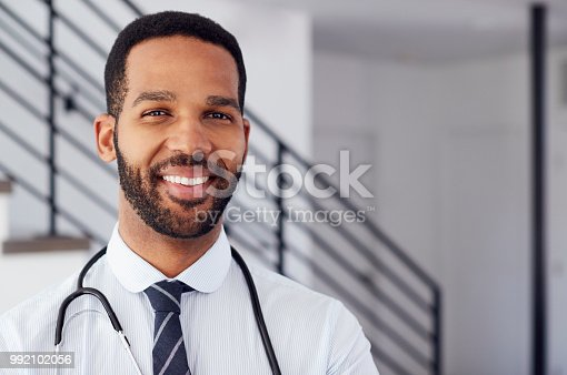 Portrait Of Male Doctor With Stethoscope In Hospital