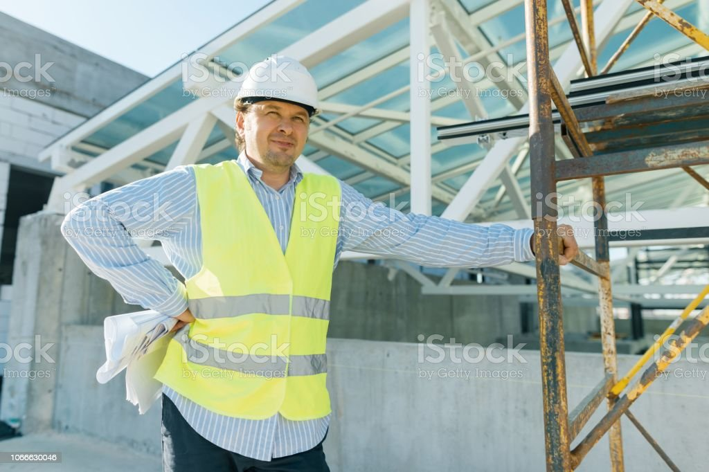 Portrait of male engineer at construction site. Building,...