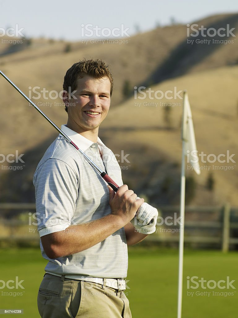 Portrait of male golfer on green royalty-free stock photo
