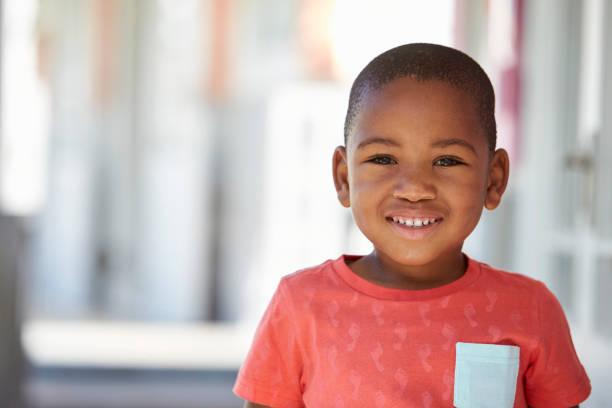 Portrait Of Male Pupil Outside Classroom At Montessori School stock photo