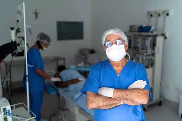 Portrait of male senior nurse at surgery on hospital picture id1198467729?b=1&k=6&m=1198467729&s=612x612&w=0&h=e6a838mtz00ul5zfupjyevodibnswrlgkf7mfgoffi0=