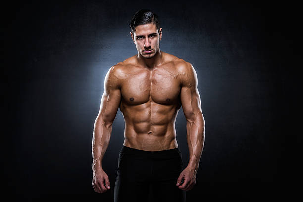 Portrait of male shirtless athlete stock photo
