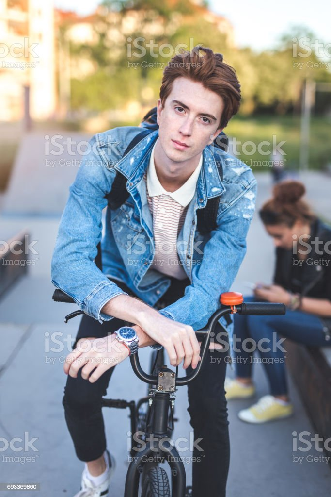 Portrait of male teenager on a BMX stock photo