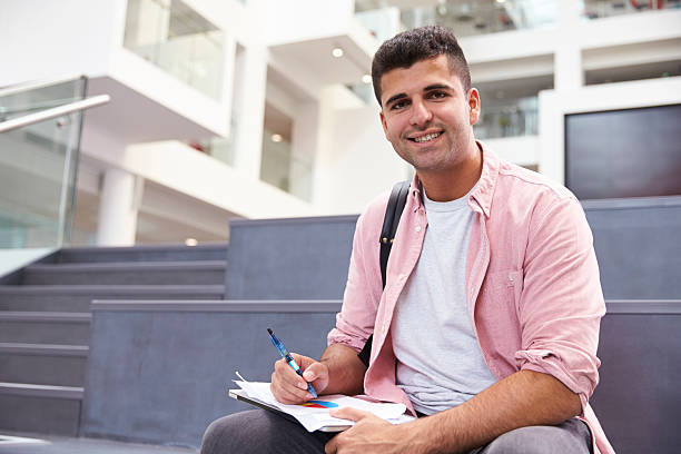 Portrait Of Male University Student In Campus Building stock photo