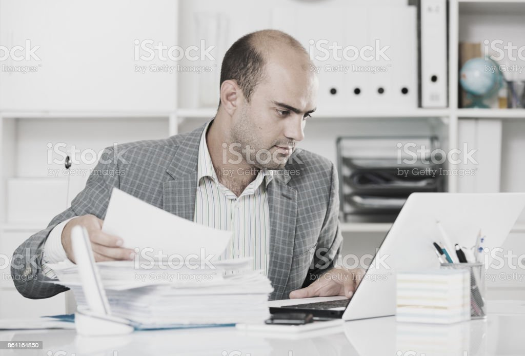 Portrait of male worker in the office sitting royalty-free stock photo