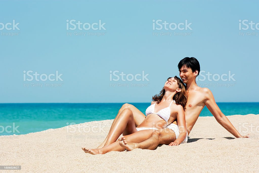 Portrait of Man and Woman at the Beach by Sea stock photo