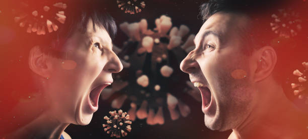 Portrait of man and woman who are yell at each other. stock photo