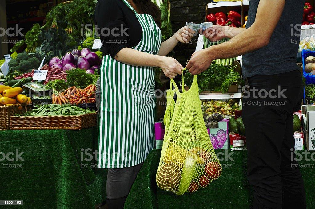 Portrait of man buying fresh food at market royalty free stockfoto