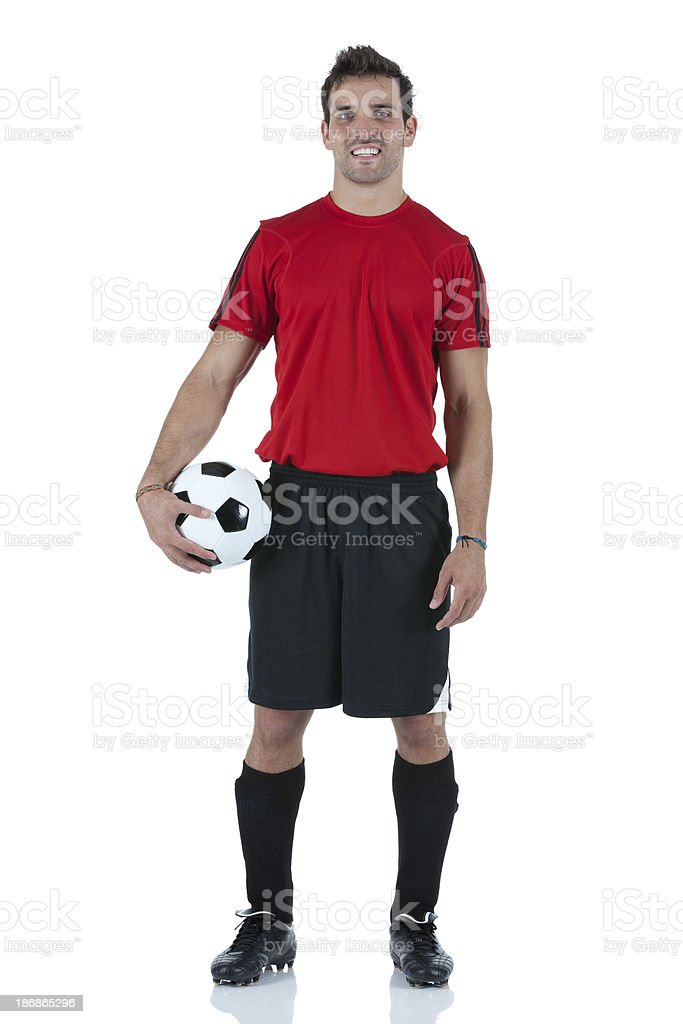 Portrait of man holding a football stock photo