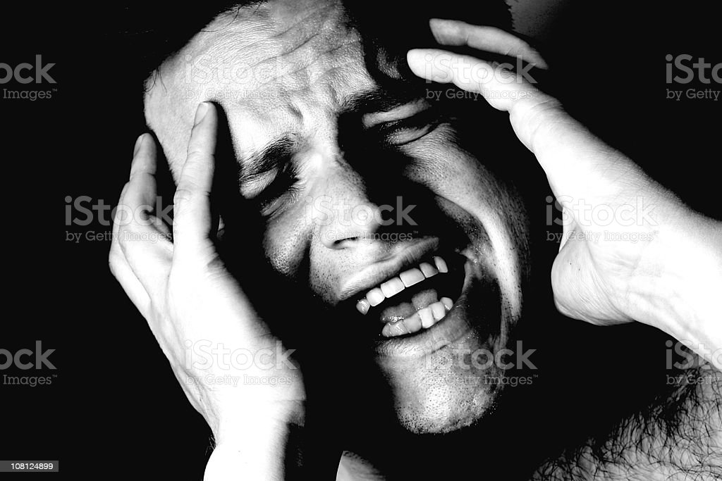 Portrait of Man Holding Head in Agony, Black and White royalty-free stock photo