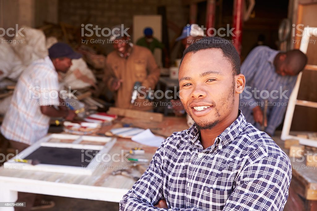 Portrait of man in a busy carpentry workshop, South Africa stock photo