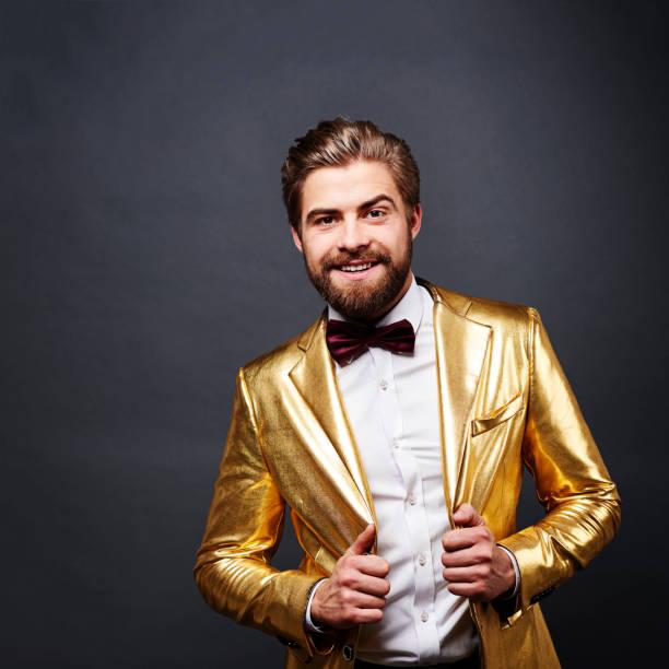 Portrait of man in golden suit Portrait of man in golden suit bow tie stock pictures, royalty-free photos & images