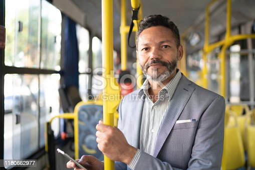 Portrait of man looking at camera on a bus