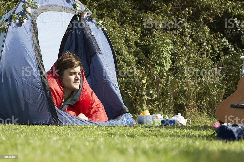 Portrait of man lying inside tent zbiór zdjęć royalty-free
