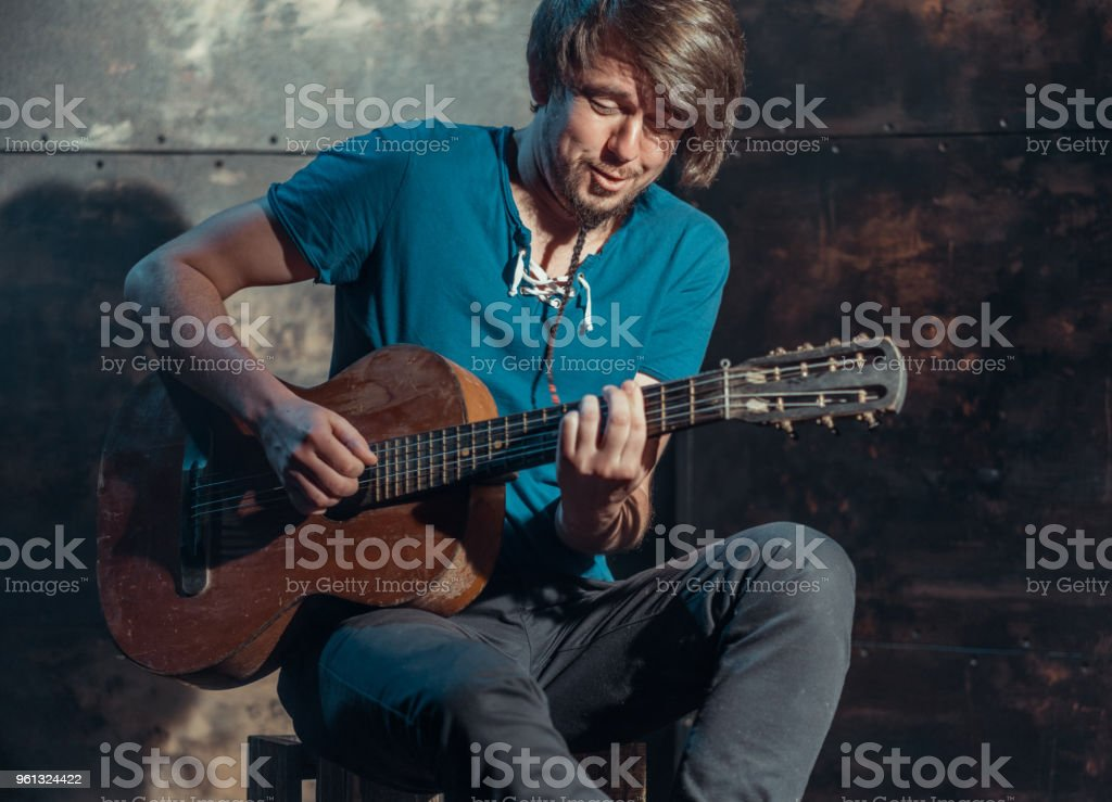Portrait Of Man Musician Playing Emotional Music On Old