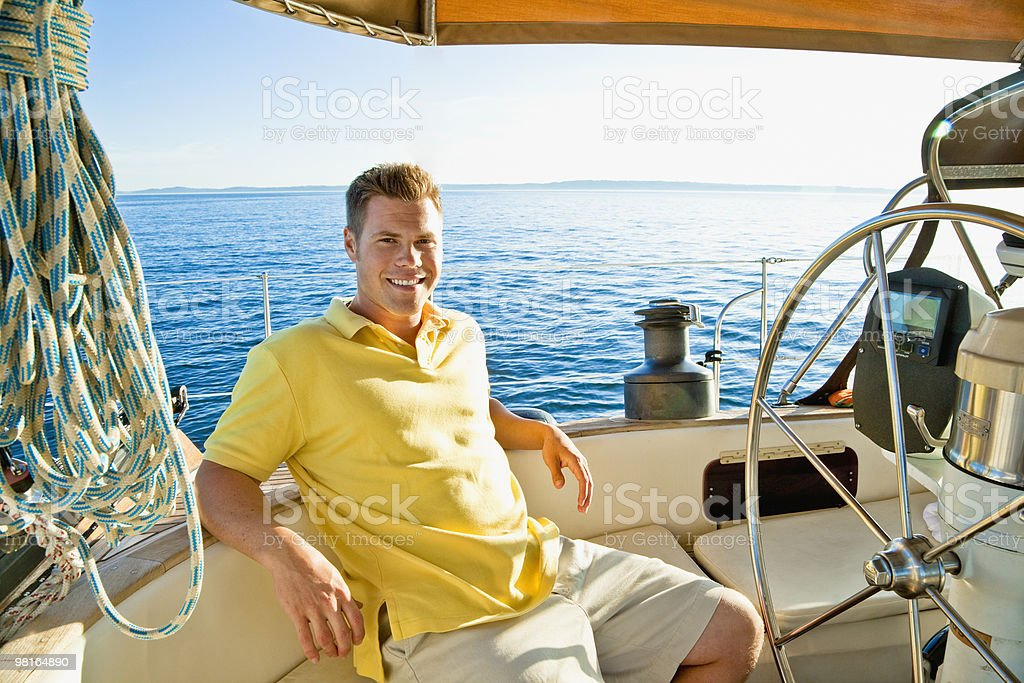 Portrait of man relaxing on sailboat at sunset royalty-free stock photo