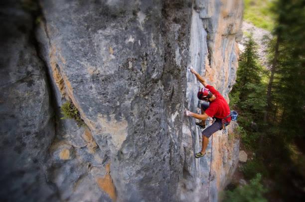 Portrait of  Man Rock Climbing Mountain Cliff stock photo