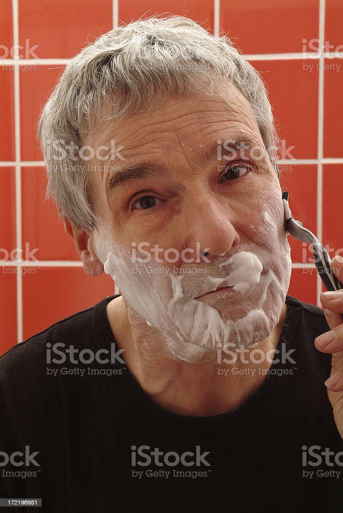 Portrait of man shaving himself royalty-free stock photo