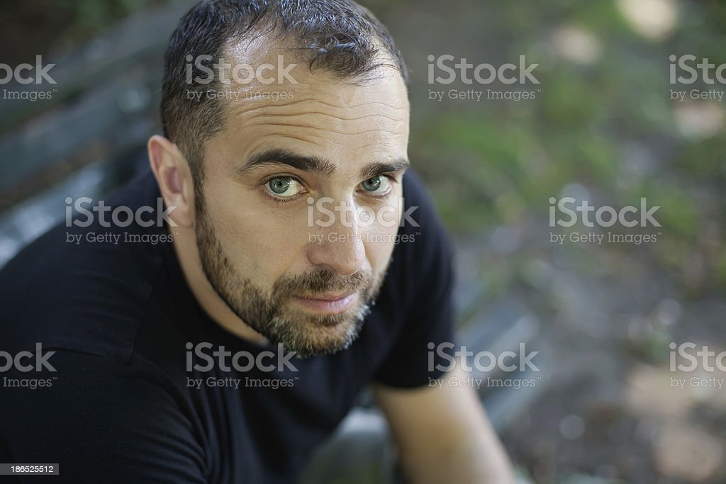 Portrait of man Sitting in the Park royalty-free stock photo