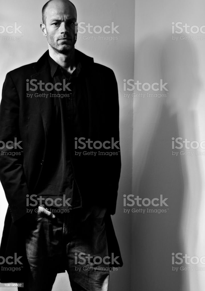 Portrait of Man Standing in Corner, Black and White stock photo
