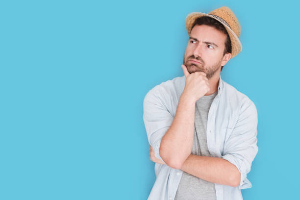 Portrait of man thinking about vacations time stock photo
