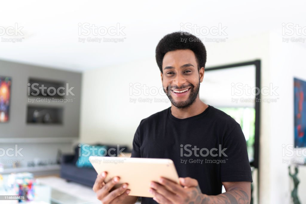 Portrait of man using digital tablet for control the home automation...